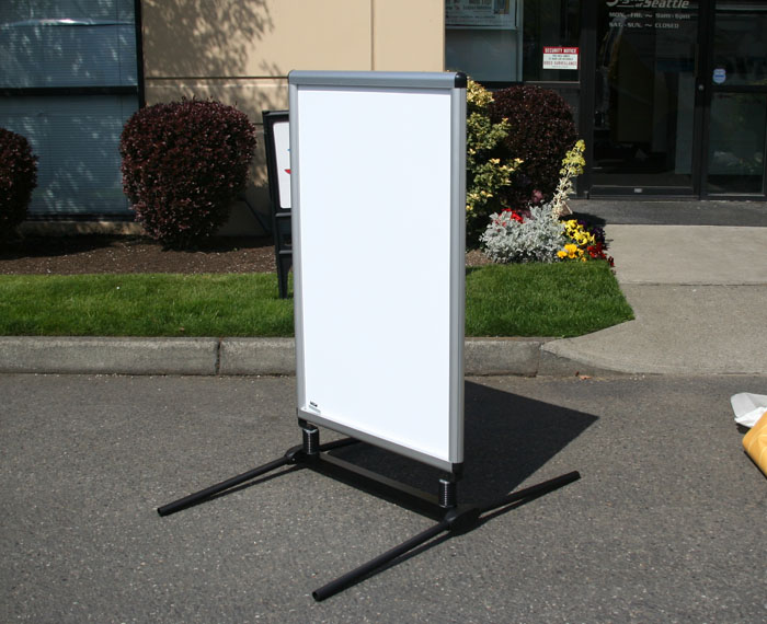 Spring-loaded Sidewalk Signs